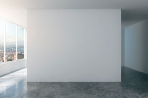 empty room in a high rise building with a dark marble floor and white walls